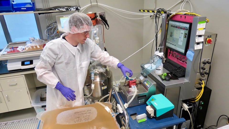 Bioprocess Training Associate operating one of BTEC's single-use bioreactor systems to culture animal cells.